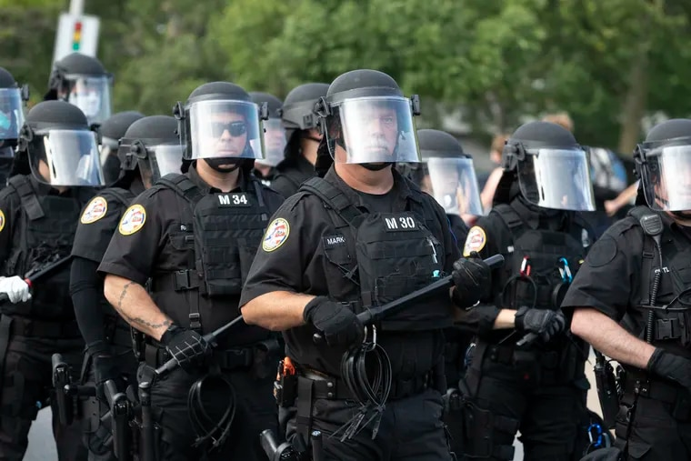 Police in riot gear on June 23, 2020, at Marconi Plaza in South Philadelphia, where tensions have erupted between protesters and residents who oppose the removal of a statue of Christopher Columbus.