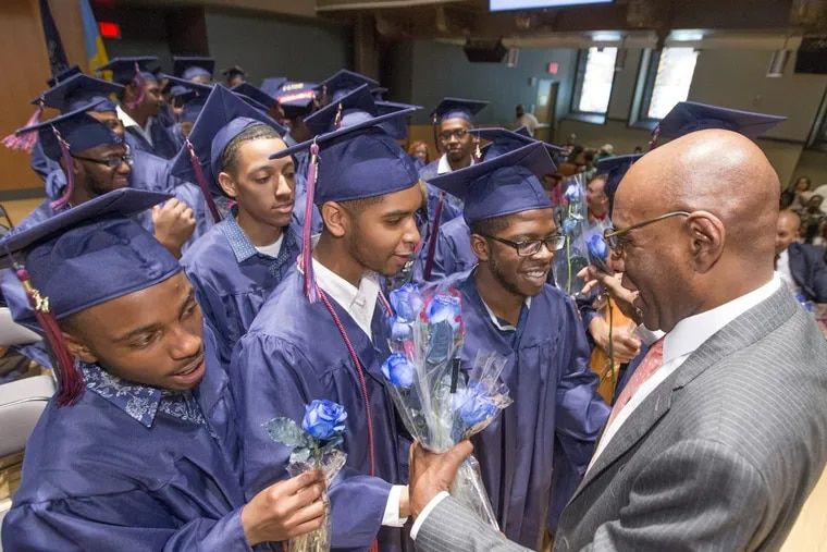 Founder and CEO David Hardy is presented roses by members of the graduating class during the Boys' Latin graduation ceremony on June 13.