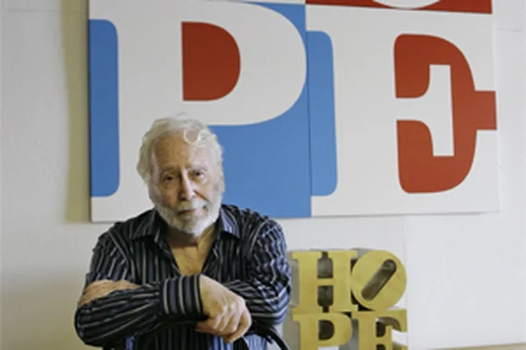 """Artist Robert Indiana in his Maine studio in August 2008, with his """"HOPE"""" design, used for raising money for the presidential run of Barack Obama. HOPE echoes Indiana's famous LOVE design."""