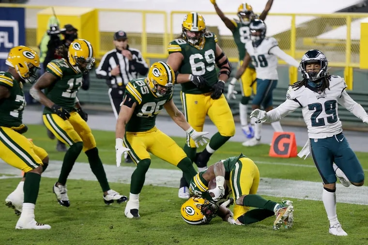 Green Bay Packers running back Aaron Jones (33) tumbles into the end zone at the tail end of his game-clinching 77-yard touchdown run Sunday in the Eagles' 30-16 loss.