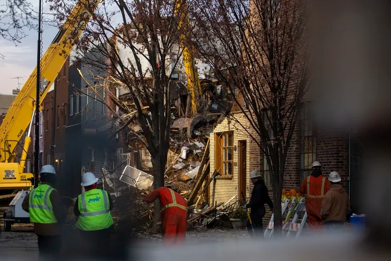 Construction workers on Saturday started taking down one of the buildings next to the few homes that were caught in this week's explosion in South Philadelphia.