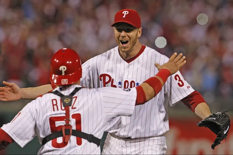 Roy Halladay and Carlos Ruiz celebrate Halladay's no-hitter in Game 1 of the NLDS in October 2010.