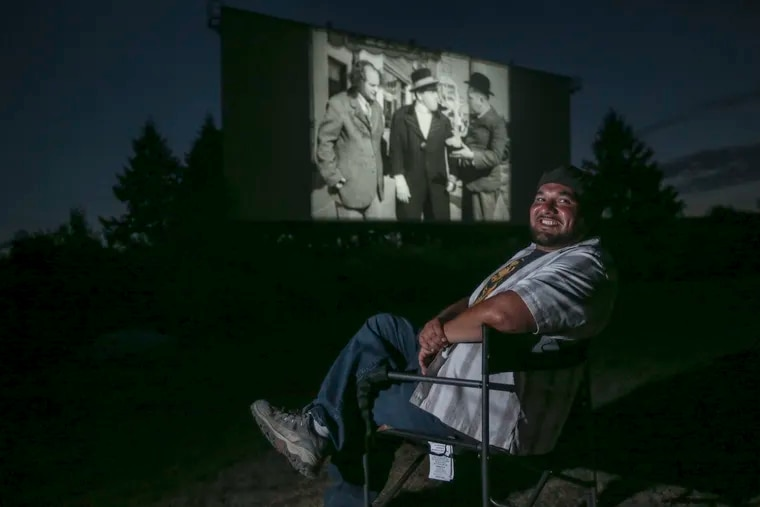 """Mahoning Drive-In operator Virgil Cardamone poses with the Three Stooges """"Pop Goes the Easel"""" at a screening July 22. The Mahoning Drive-In was slated to close as a Connecticut solar-energy company eyed its land. But a grassroots push by the drive-in's legions of fans convinced the company to abandon the plan."""
