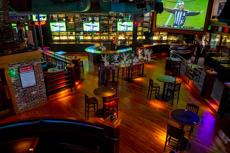 The normally packed Chickie & Pete's sports bar and restaurant in South Philadelphia is empty during an Eagles game, since the city instituted a ban on indoor dining.
