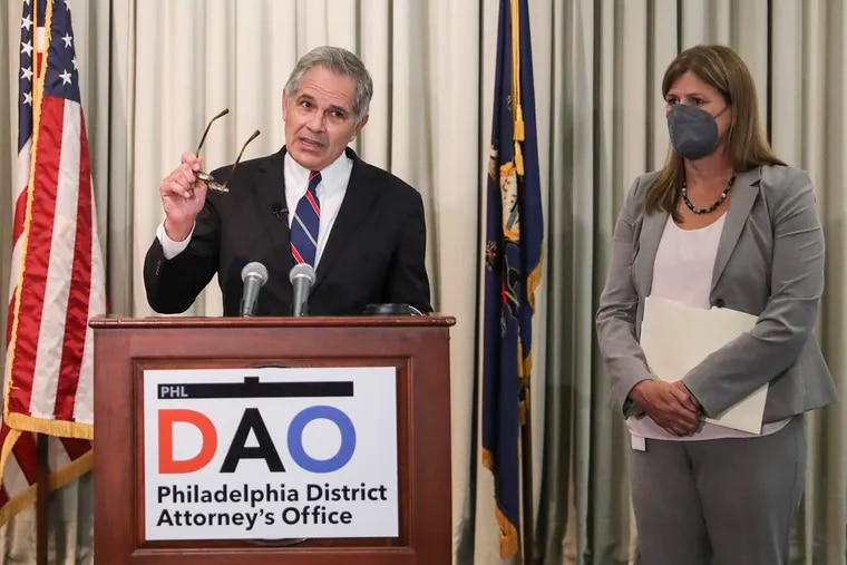 Philadelphia District Attorney Larry Krasner speaks at the podium next to Patricia Cummings, Supervisor of the Conviction Integrity Unit, during a news conference announcing charges against three former city detectives for perjury in a decades-old murder case at his Center City office on Friday. Detectives Martin Devlin, Manuel Santiago, and Frank Jastrzembski face charges of perjury and false swearing in the case of the 1993 rape and murder of 77-year-old Louise Talley in Nicetown. Anthony Wright was convicted and retried in 2016 before his conviction was overturned. Wright served 25 years of wrongful imprisonment, and said that detectives fabricated evidence and subjected him to a physically abusive interrogation before forcing him to sign a false confession.