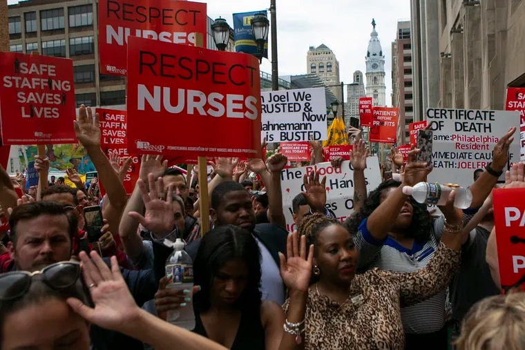 A large crowd of people rally outside of Hahnemann University Hospital to save it from closure on Thursday, July 11, 2019. It was announced last month that the hospital would be closing.