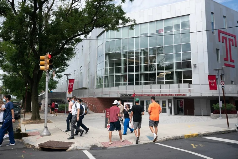 People walk on campus at Temple University, where classes started Monday.