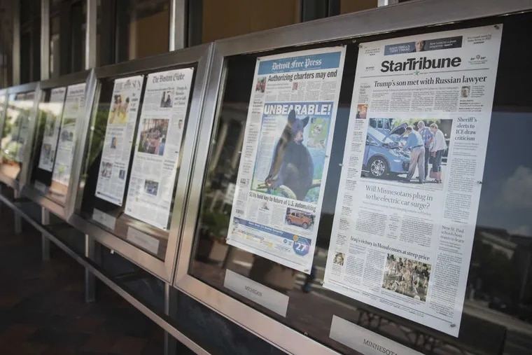 Newspaper front pages are displayed at the Newseum in Washington on Monday.