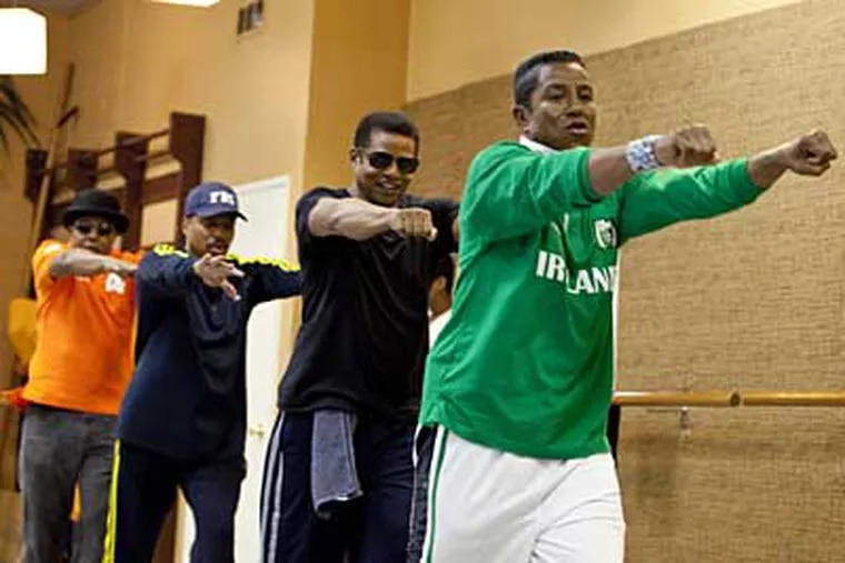 "From left: Tito, Marlon, Jackie and Jermaine Jackson rehearse in Los Angeles. A new reality show, ""The Jacksons: A Family Dynasty""  premieres Sunday on A&E. (AP Photo/A&E, Richard Knapp)"