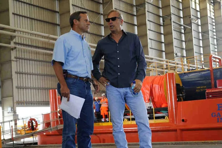 BP honcho Doug Suttles and actor Kevin Costner. Maybe they're talking about that $18 million deal.