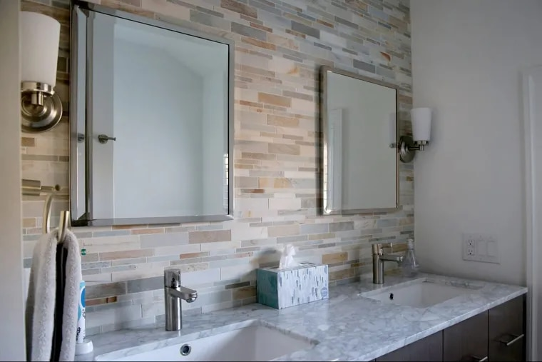 The tile budget for this Merion Station home was $20,000, including this earth-tone mosaic wall.