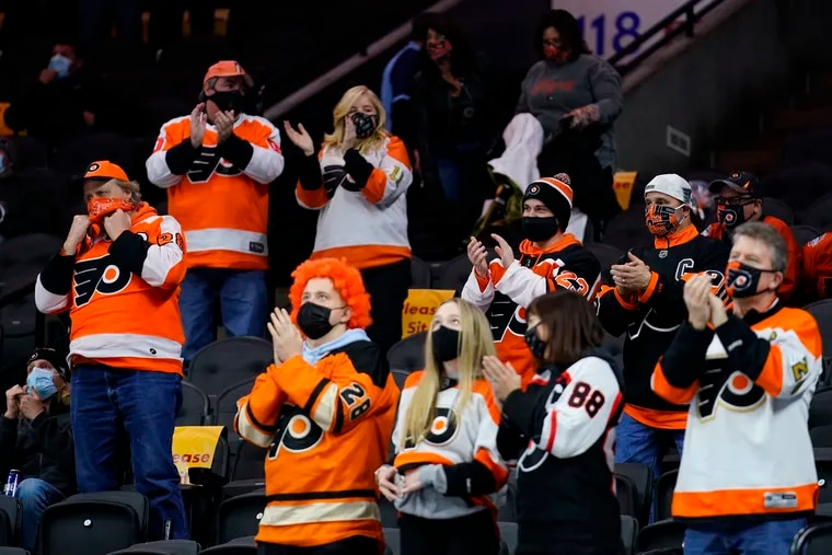 Fans cheer during the second period of a  game between the  Flyers and the Washington Capitals on March 7.