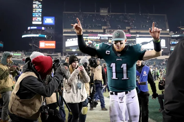 Carson Wentz celebrates while leaving the field after the Eagles' win over the Dallas Cowboys on Sunday.