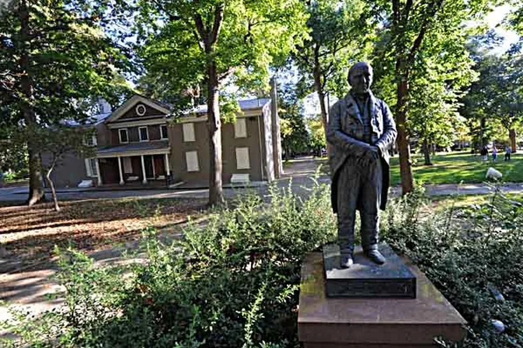 A statue of Stehpen Girard stands in the middle of Girard Park, located between 21st and 22nd Sts. and Shunk and Porter Sts.  The mansion in the background is Girard's farmhouse.  ( CLEM MURRAY / Staff Photographer )