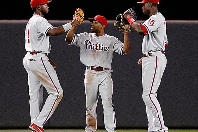 Phillies outfielders Ben Revere, Domonic Brown and John Mayberry Jr. (Genevieve Ross/AP)