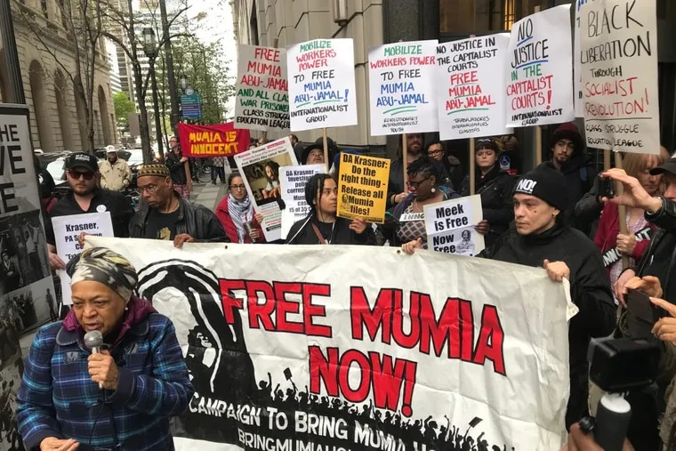 Supporters of Mumia Abu-Jamal gather outside the Criminal Justice Center. where a hearing in Common Pleas Court on a challenge to his conviction was being held.