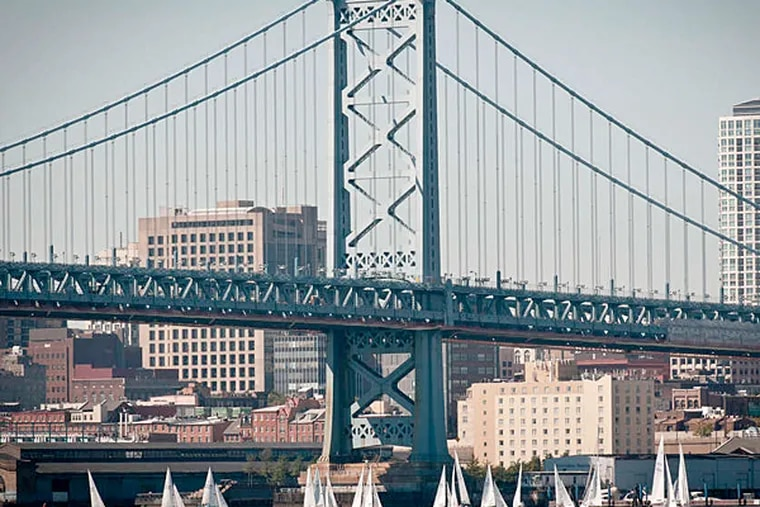 Sailboats float at the base of the Ben Franklin Bridge. (Ron Tarver / Staff Photographer)