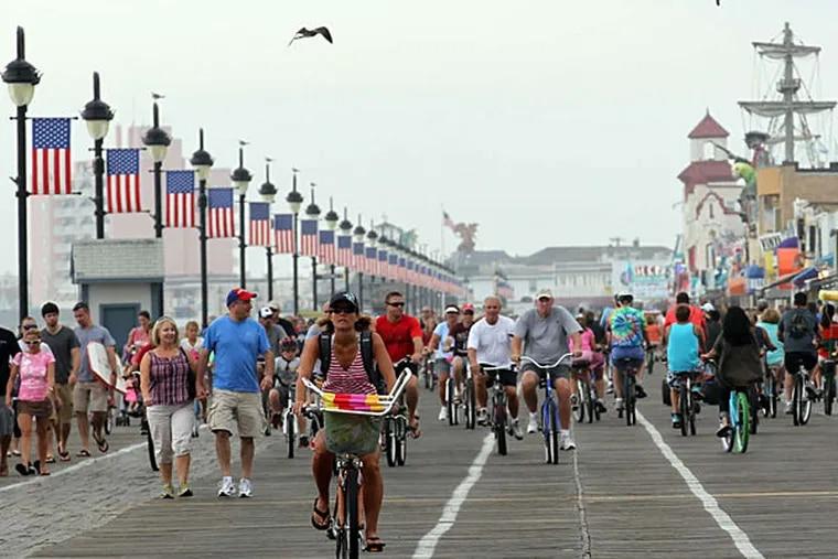 Pedestrians and bike riders enjoy the Ocean City Boardwalk. Ocean City also won the crown in 2009. (Yong Kim/Staff/File)