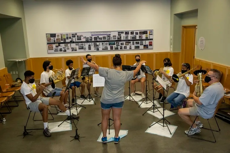 Teacher Sabrina Huber conducts the brass chamber ensemble during the All-City Orchestra Summer Academy at the Mann Center for the Performing Arts.