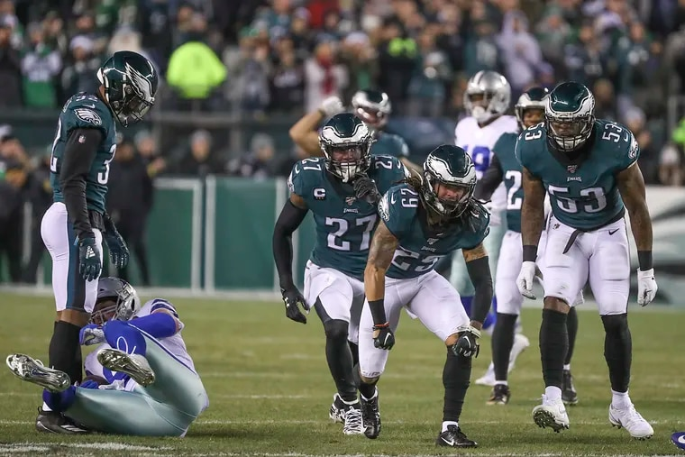 Eagles cornerback Avonte Maddox celebrates after bringing down Dallas Cowboys tight end Jason Witten in the first half of a game at Lincoln Financial Field in South Philadelphia on Sunday, Dec. 22, 2019.
