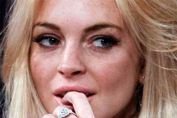 Why is Lohan really appearing nude in Playboy?