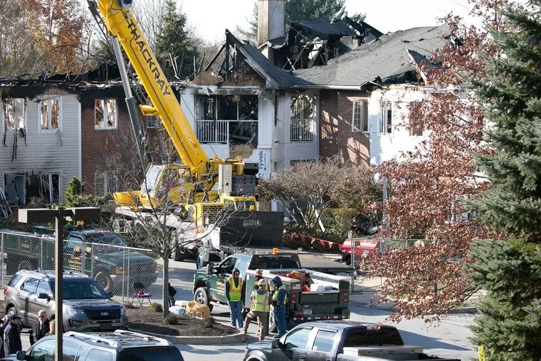Investigators and workers at the scene of the Barclay Friends Senior Living Community in West Chester after the five-alarm fire in November 2017.