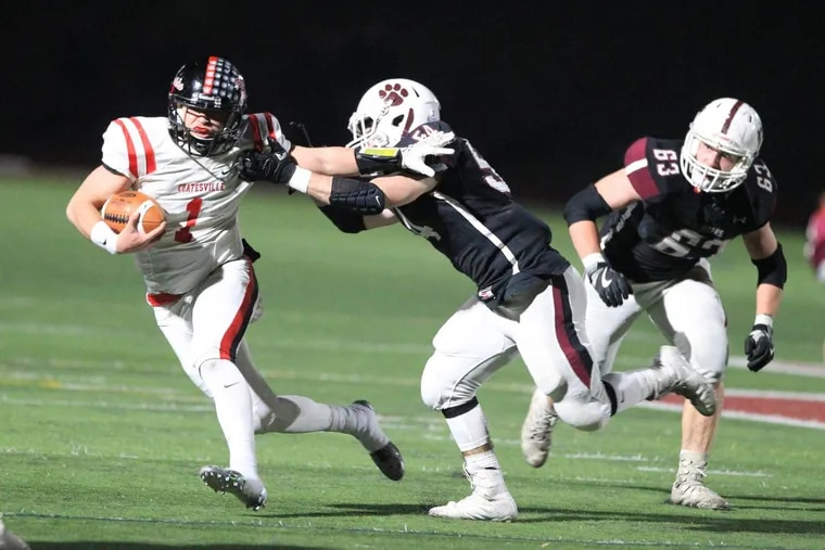Ricky Ortega, left, of Coatesville tries to break awy from Tom Deaver, center, of Garnet Valley in a District 1, group 6A, championship game on Nov. 24, 2017.