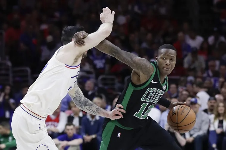 Celtics guard Terry Rozier commits a foul while trying to get by the Sixers' JJ Redick during the second quarter of Game 4.