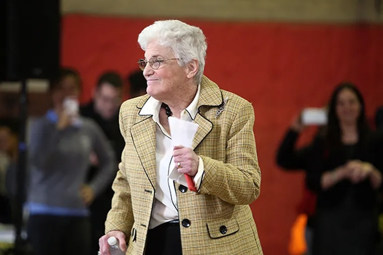 Lynne Abraham dances to her seat at the Youth Summit Strategy Session forum in Philadelphia on Tuesday, April 8, 2015. ( STEPHANIE AARONSON / Staff Photographer )