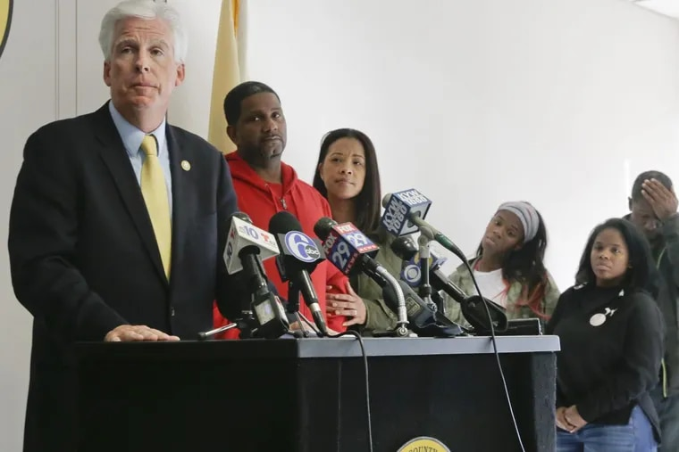 With members of the Carter family in the background, Gloucester County Prosecutor Sean Dalton announces an arrest in the killing of Shawneeq Carter, the young woman beaten to death while she was housesitting for a friend. Her body was found by two 5-year-olds — her son and a nephew, on Nov. 17.