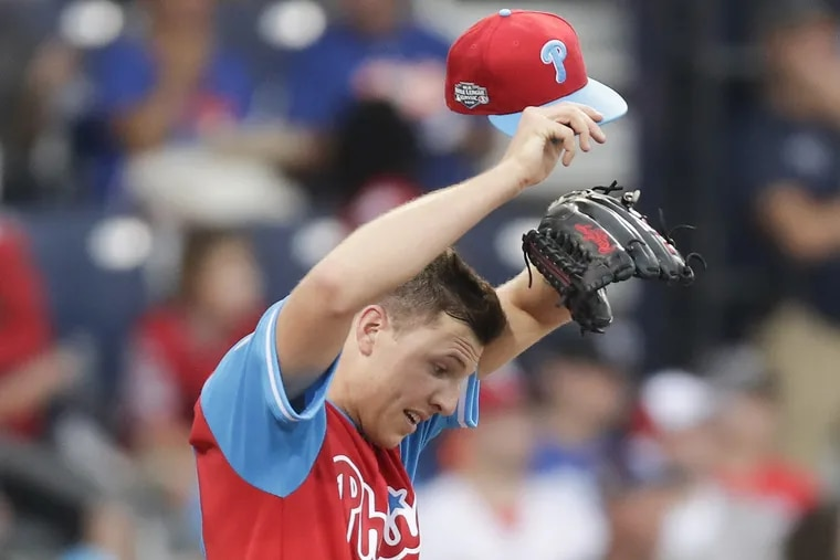 Phillies starting pitcher Nick Pivetta wipe his head after giving up four runs in the second inning against the Mets in the Little League Classic at BB&T Ballpark at Historic Bowman Field in Williamsport on Sunday.