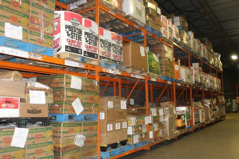 Food flows in and out of the Philabundance warehouses, one of the city's largest non-profit food banks.