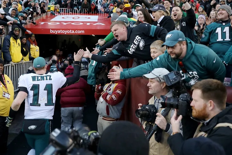 Eagles fans cheer for quarterback Carson Wentz (11) as he leaves the field after Sunday's win over the Washington Redskins.