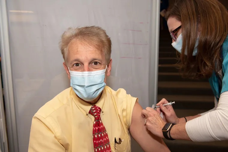 John J. Zurlo, a physician at Thomas Jefferson University Hospital, rolls up his sleeve to get a COVID vaccine on December 16, 2020.