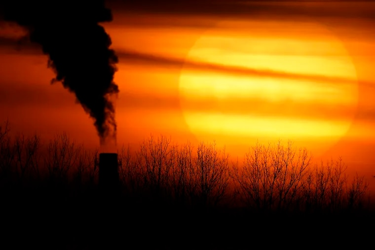 """Emissions from a coal-fired power plant are silhouetted against the setting sun in Independence, Mo. A United Nations report released Monday warned that current climate change is a """"code red for humanity."""""""