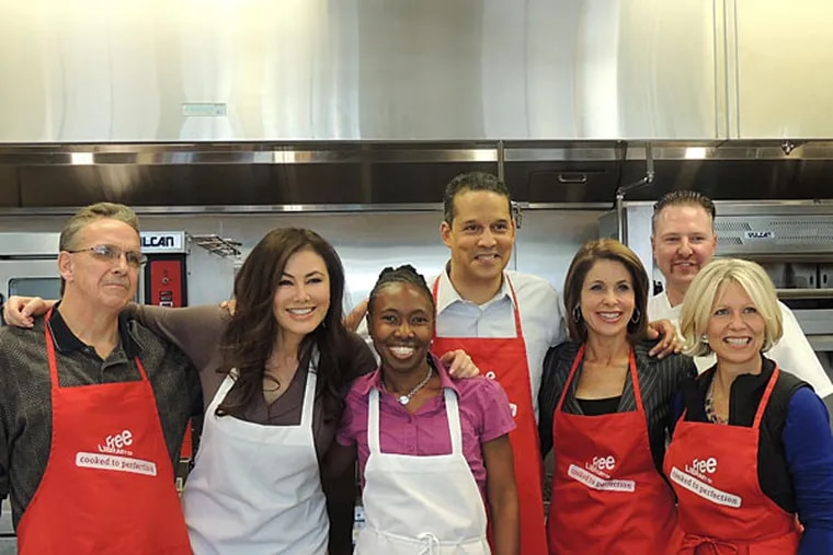 Three local TV personalities cooked for a cancer benefit with three cancer survivors. Here: Andrew Slachta, Fox 29's Lucy Noland, Rhonda Ulmuer, Fox 29 Iain Page, CBS3's Kathy Orr, Chef Steve Irlenborn and Laing Meyer.