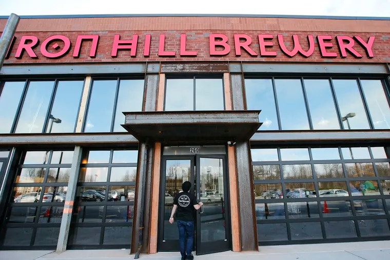 A staff member enters the Iron Hill Brewery TapHouse in Exton.