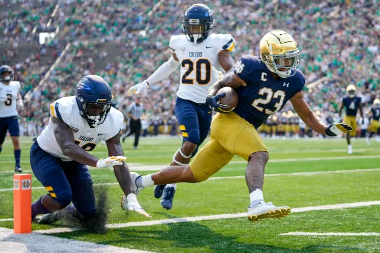 Notre Dame running back Kyren Williams (23) scores a touchdown in front of Toledo's Saeed Holt (20) and Nate Givhan (48) on Saturday. The game was available to watch on Peacock.