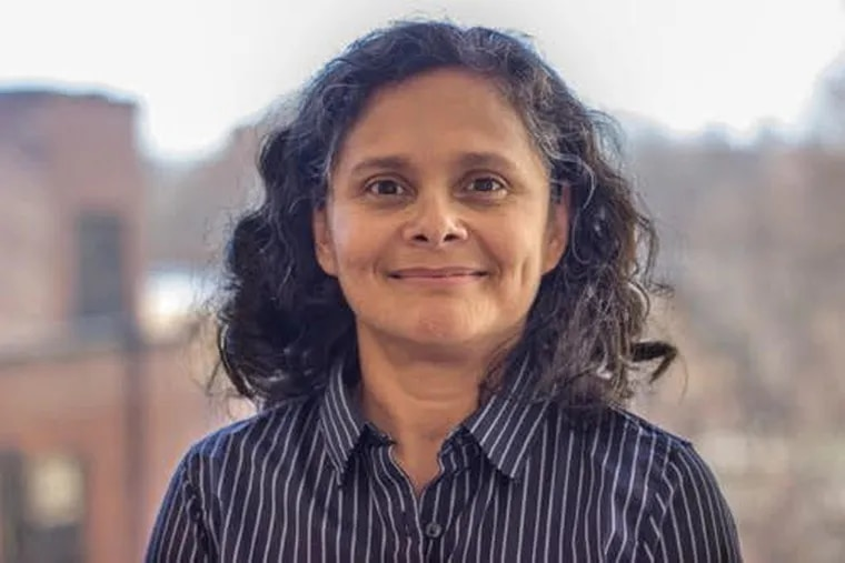 Haydee Herrera-Guzman, associate professor of mathematics at Rutgers-Camden, is one of five faculty members who filed a lawsuit a year ago against Rutgers over pay inequities. She was offered a salary bump this week, but it doesn't come close to giving her equity, she said.
