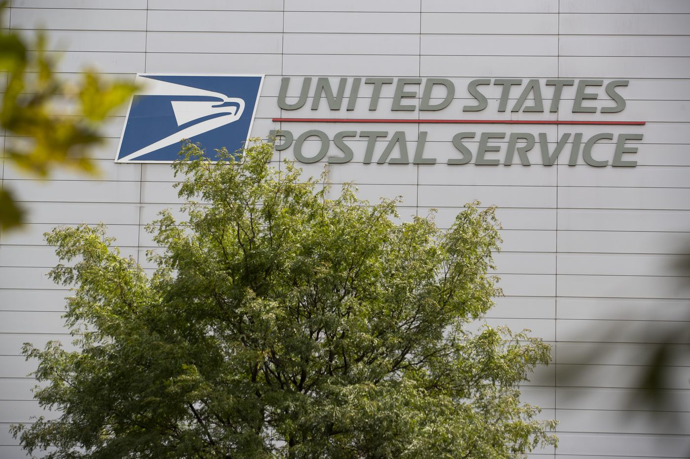 A few USPS plants are reinstalling mail sorting machines. But in Philly, more changes that could cause delays are happening.
