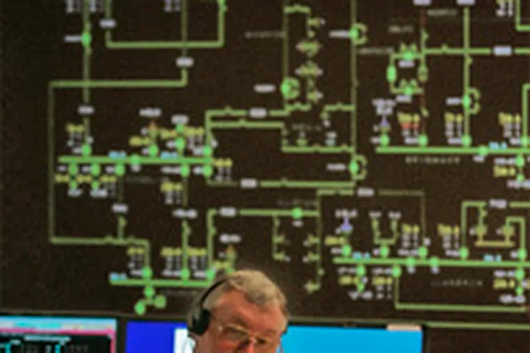 Dave Kimmerle, at Peco's monitoring site in Plymouth Meeting. A computerized schematic shows the five-county power system.