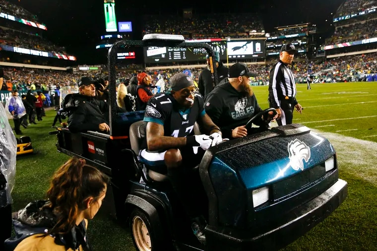 Eagles wide receiver Alshon Jeffery is carted off the field during the second quarter on Monday.