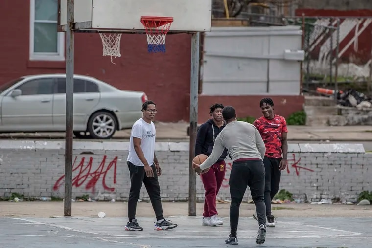 Basketball players at the West Mill Creek playground were not practicing social distancing as they played a game of two on two Tuesday afternoon.  Some playgrounds in the city still have basketball hoops up and people congregating to play games.