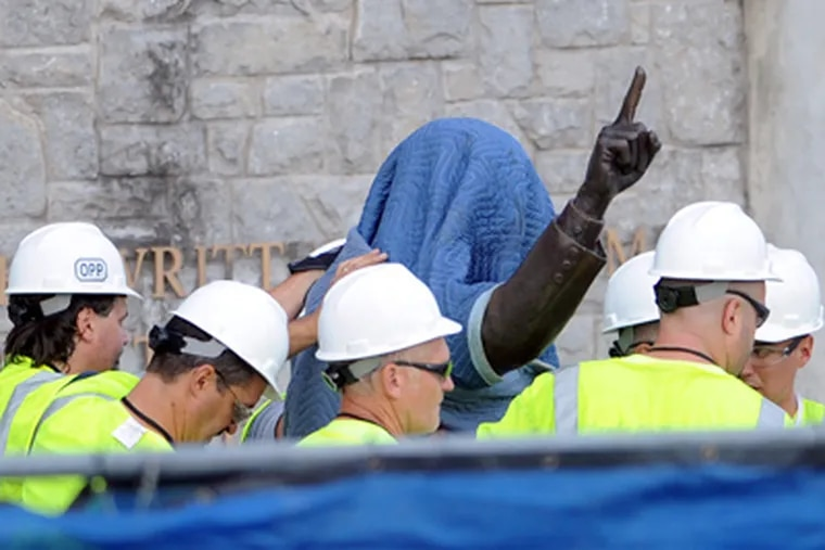 Workers handle the statue of former Penn State football coach Joe Paterno before removing the statue Sunday, July 22, 2012, in State College, Pa. (AP Photo/John Beale)