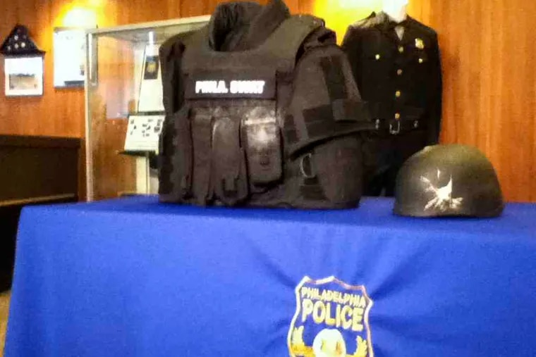 Kevlar vest and helmet worn by officers involved in shooting.