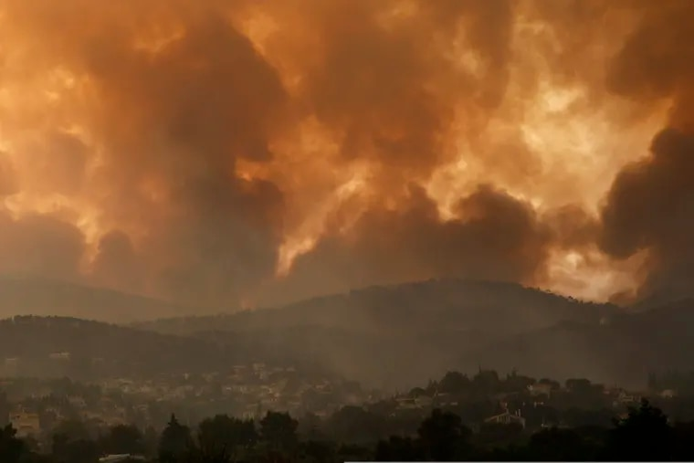 Smoke spreads over Parnitha mountain during a wildfire in the village of Ippokratios Politia, Greece, about 21 miles north of Athens, last week.