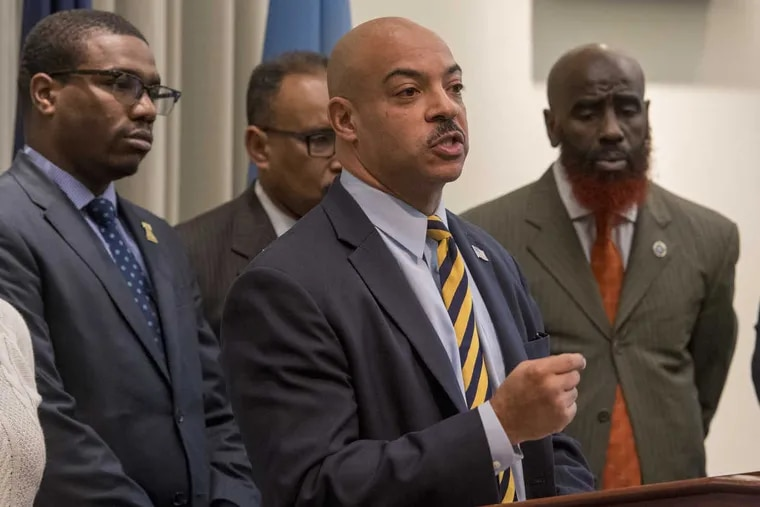 Philadelphia District Attorny Seth Williams announces he is implementing new protocols for investigating police-involved shootings in an effort to be more transparent and accountable to the public.  Behind Williams are Kevin Harden, Jr., president of the Barristers Association of Philadelphia; George Mosee, first district attorney; and Tariq El-Shabazz, deputy of the DA's Investigations Division.
