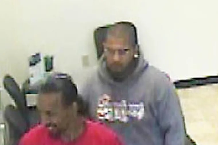 """Camden authorities are seeking help in identifying two """"persons of interest"""" shown here returning a rented truck used in an April homicide."""