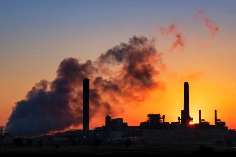 FILE - A coal-fired power plant. (AP Photo/J. David Ake, File)