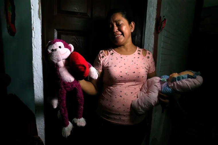 Rosa Ramirez sobs as she shows journalists toys that belonged to her nearly 2-year-old granddaughter Valeria in her home in San Martin, El Salvador, Tuesday, June 25, 2019. The drowned bodies of Ramirez's son, 25-year-old Oscar Alberto Martinez Ramirez, and his daughter were located Monday morning on the banks of the Rio Grande, a day after the pair were swept away by the current when the young family tried to cross the river to Brownsville, Texas. Her daughter-in-law Tania Vanessa Avalos, 21, survived.